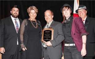 Travis Scheuer, Coral Pleas, and Taelor Scheuer accept the award for Young Business of the Year